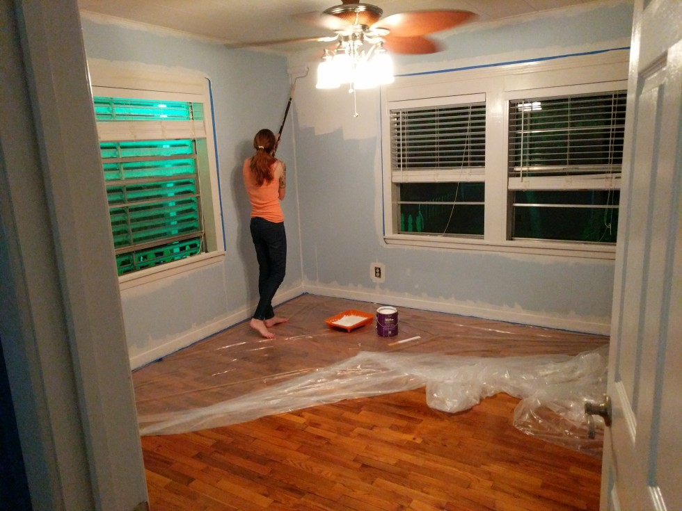 Applying primer to the walls